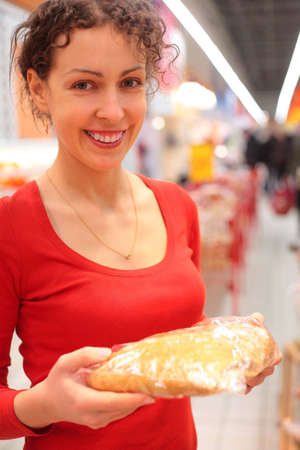 Young woman in shop with bread Stock Photo - 5368596