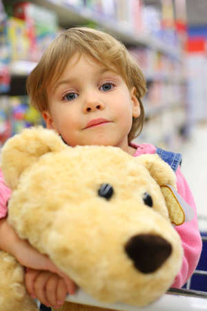 soft sell: girl with soft toy in shop