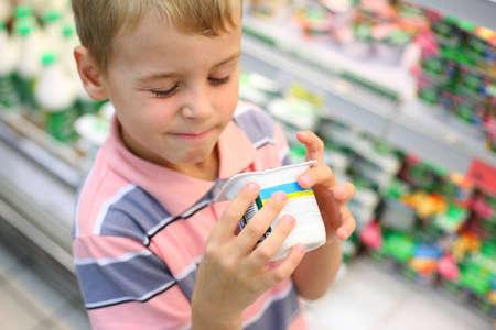 Boy in shop with yoghurt photo