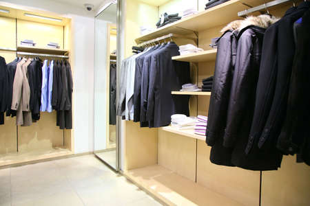 togs: clothes on racks in shop