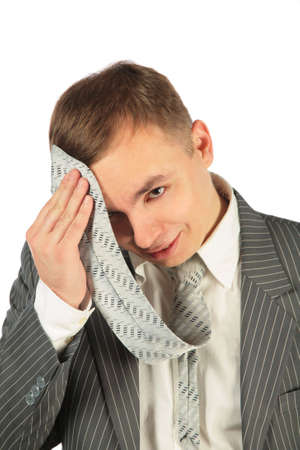 thorough: Tired Man with tie on a white background  Stock Photo