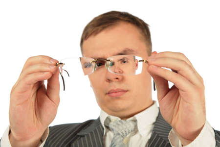considers: Man considers spectacles glasses   Stock Photo