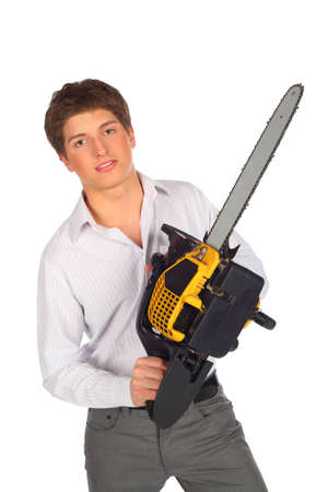 Young man with chainsaw photo