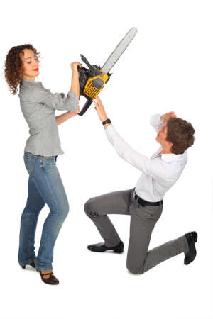 young man is protected from girl with chain saw photo