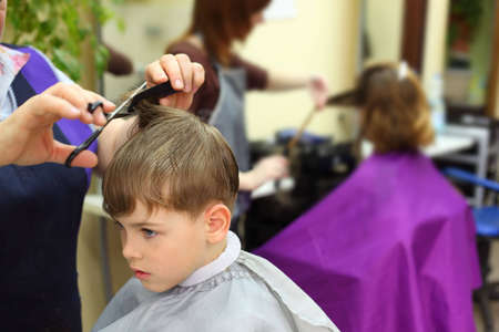 Boy in hairdressing salon Stock Photo - 5354719
