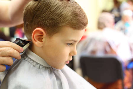 short haircut: Boy cut in hairdressers machine