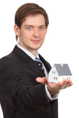 young man holding home Stock Photo - 5361228