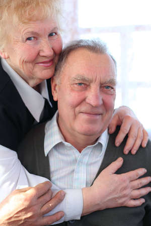 Portrait of elderly pair looking at camera Stock Photo - 5361245