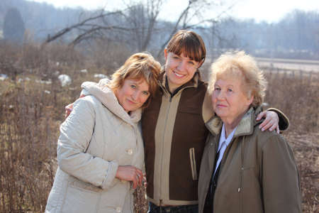 Women of three generations of one family, spring outdoor  photo