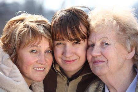 three persons: Portrait of women of three generations of one family, faces
