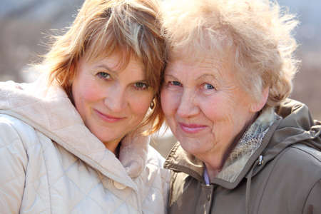 Elderly woman and her daughter photo