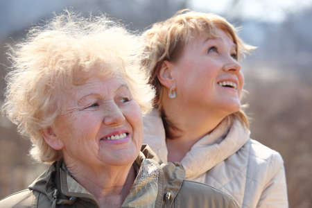 Smiling elderly woman and her daughter
