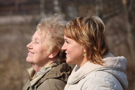 Smiling elderly woman and her daughter in profile Stock Photo - 5361249