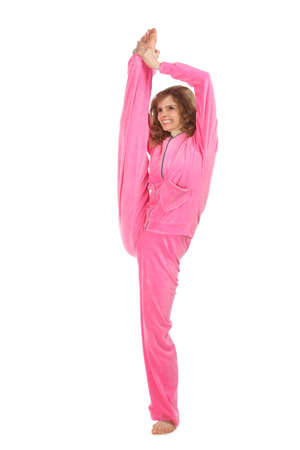 Girl in pink clothes holds leg vertically upwards Stock Photo - 5358924