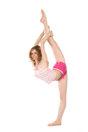 versatile: Smiling girl in sportswear does gymnastic exercise
