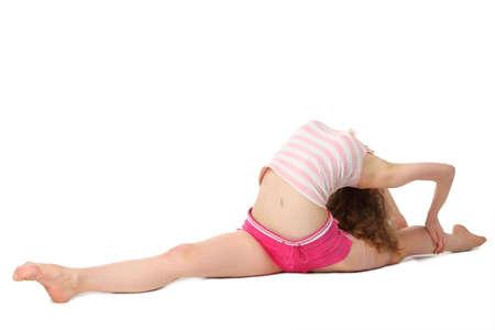 legs apart: Chica en ropa deportiva hace gimnasia en el piso, lo que divide Foto de archivo