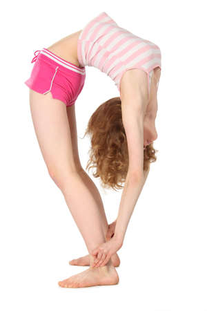 Sports flexible girl in return inclination Stock Photo - 5358684