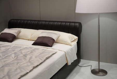 Bedroom with floor lamp photo