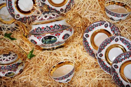 teaset: Tea-set in shavings Stock Photo