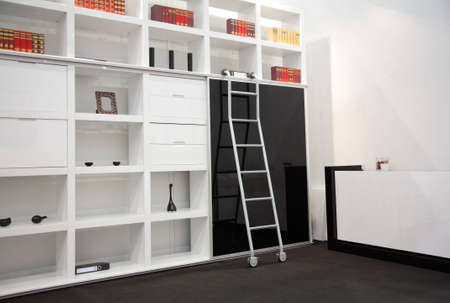 white room with book cabinet photo