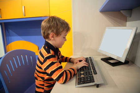 boy at computer in children's room Stock Photo - 5354722