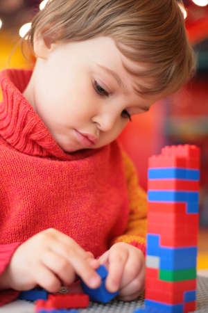 little girl plays with plastic constructor Stock Photo - 5354663