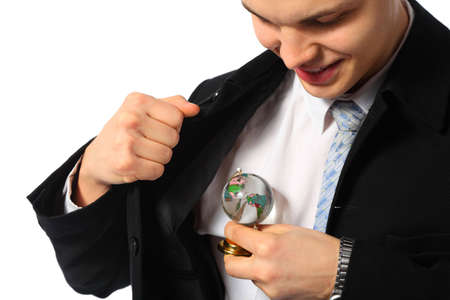 young businessman with glass globe in hand photo
