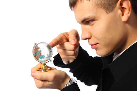 young businessman touches finger glass globe in hand photo
