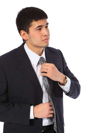 corrects: young �sian businessman corrects  tie Stock Photo