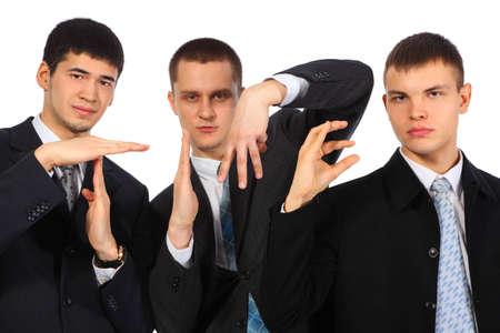Three businessmen show word time Stock Photo - 5364500