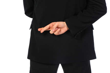 Businessman with fingers crossed behind his back photo