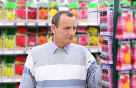 elderly man in shop of seeds Stock Photo - 5368120