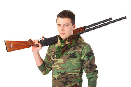 man in camouflage with gun on shoulder  photo