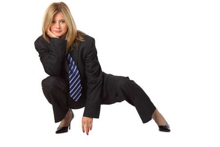 Young pretty businesswoman in big suit squats photo