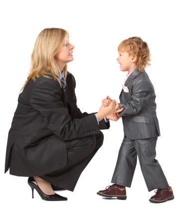 Young businesswoman in husband suit and son photo