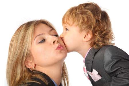 Boy in suit kisses mother photo