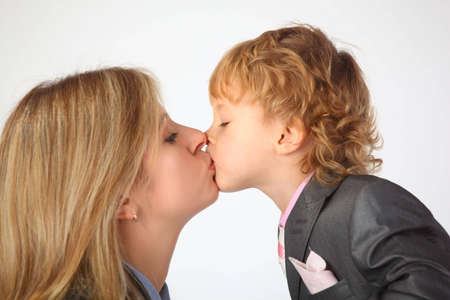 Mother and son kiss photo