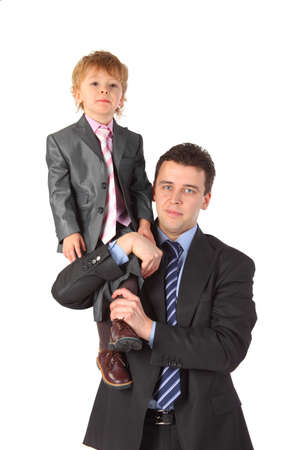 dynasty: Businessman hold boy on shoulder, business dynasty Stock Photo