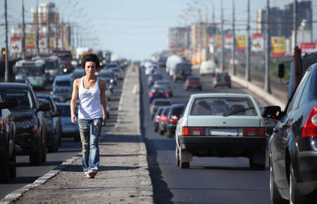 girl goes on highway middle in city photo