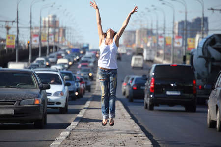 girl jumps on highway middle photo