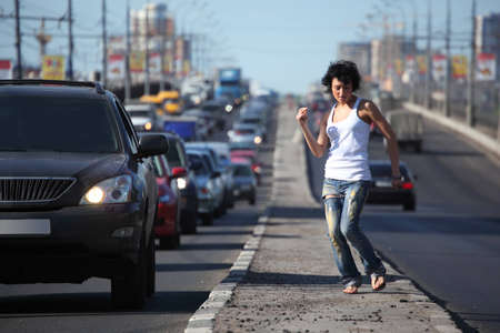 girl dances on highway middle photo