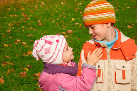 sister and brother play in autumnal park Stock Photo - 7836902