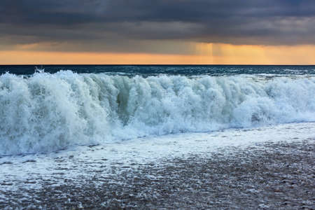 appeared: Sea coast with waves, wide angle; sun appeared through clouds