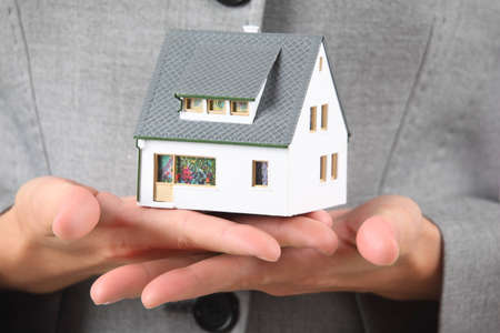 hands with model of house Stock Photo - 7765604
