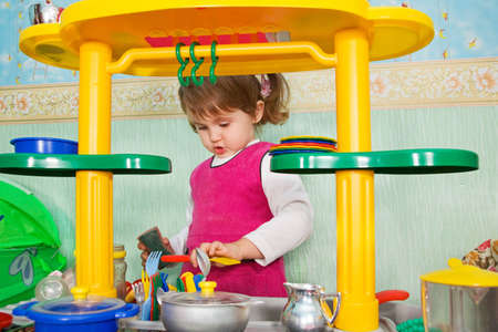 little girl washes ware photo