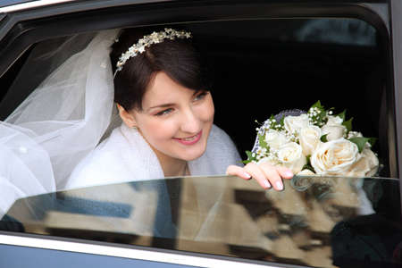 smiling bride in the car photo