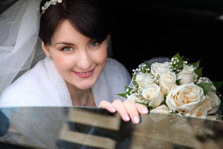 happy bride in the car photo
