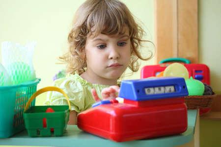little girl plays shop photo