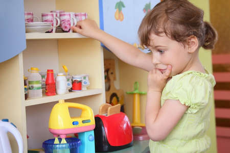 oven and range: young girl thinking on kitchen