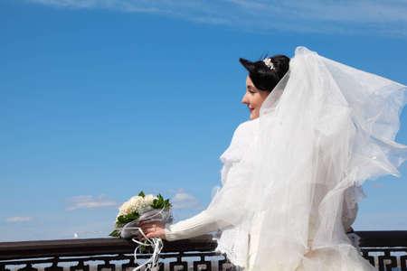 parapet: bride with bouquet at parapet